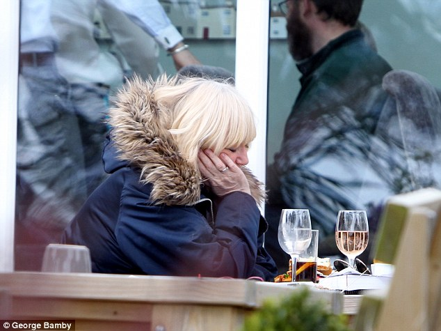 Sleepy Judy Finnigan rests her eyes during boozy lunch with husband Richard Madeley as the duo enjoy blissful Cornwall getaway